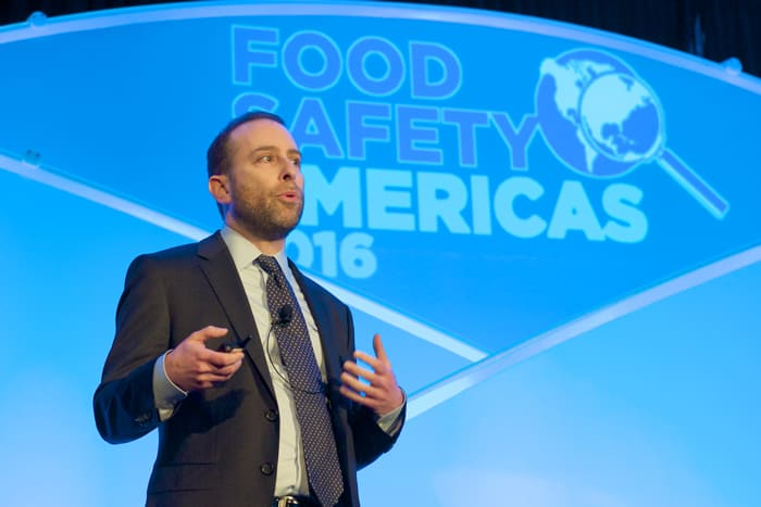 Evan Rosen Vice President of QA at PacMoore Speaking on stage at a Food Safety Americas Conference in 2016
