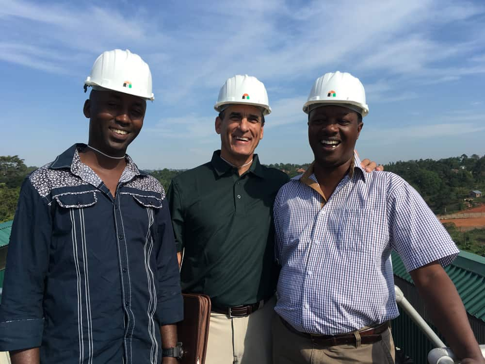 Bill, Innocent and Peter, the general manager at Savanah grain processing facility.