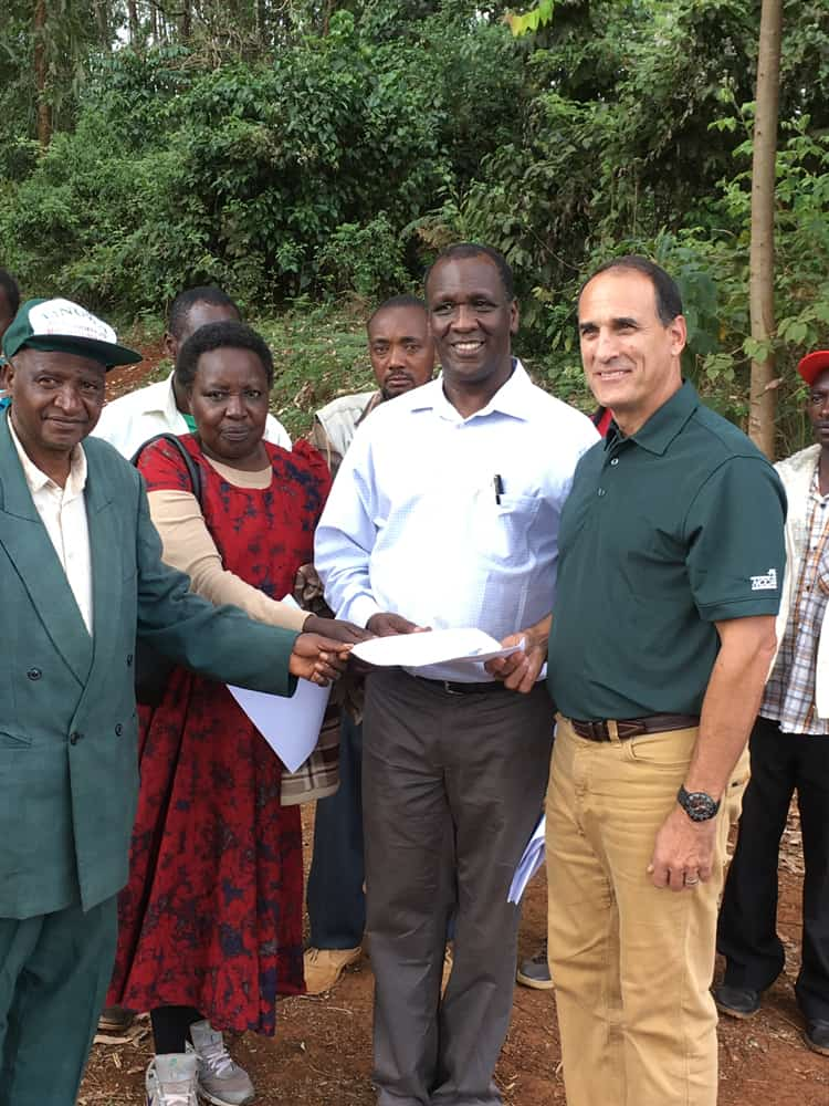 The official signing of the agreement between PacMoore and the local community group to work together on the Kenya honey project.